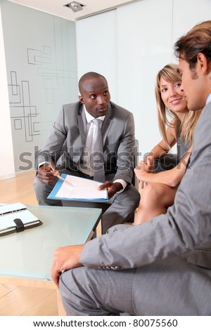 Business people meeting in lounge room - stock photo