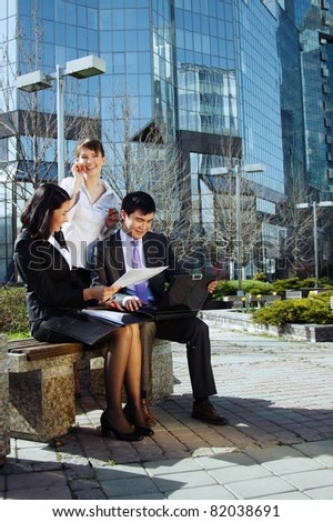 Business people meeting outdoor in front of office building - stock photo