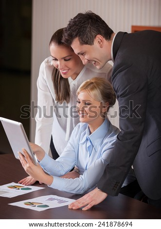 Business people meeting to discuss the situation on the market, office
