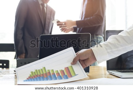 Business people meeting to discuss the situation on the market.Vintage tone, Retro filter effect, Soft focus, Low light.(selective focus)â?¨ - stock photo