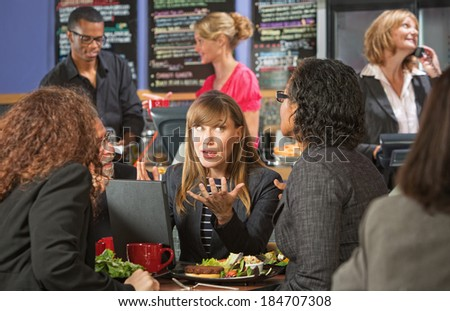 Business people meeting with laptop in cafe - stock photo