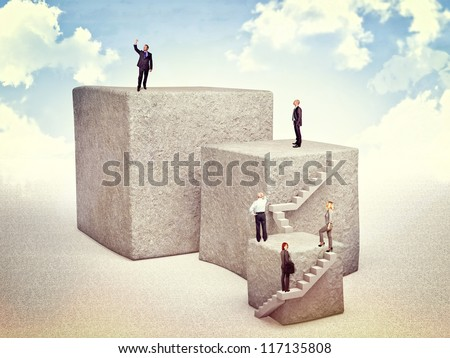 business people move up on 3d huge cube - stock photo