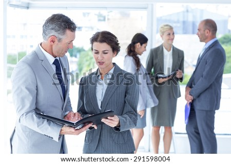 business people negotiating in the office - stock photo