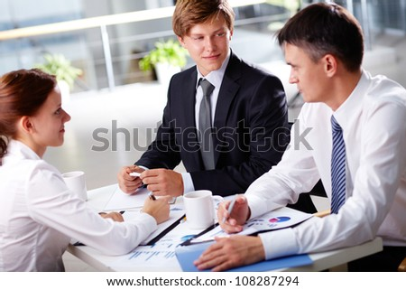 Business people of different ages forming a solid team ready to cooperate - stock photo