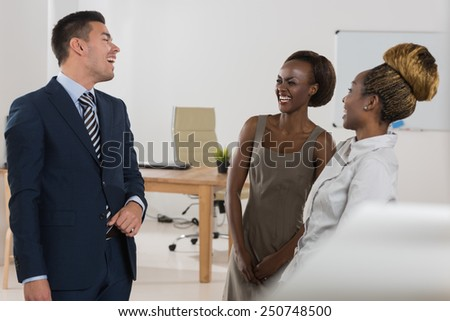 Business people of different human races chatting at office together