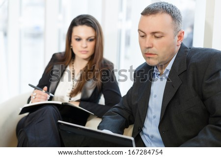 Business people on a business meeting using laptop