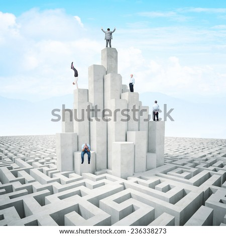 business people on abstract 3d tower with maze