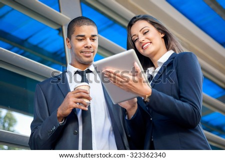 Business people on coffee break using digital tablet - stock photo