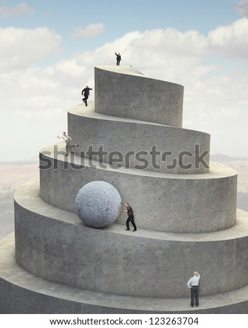 business people on 3d abstract success tower - stock photo