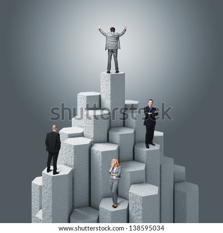 business people on 3d concrete tower - stock photo