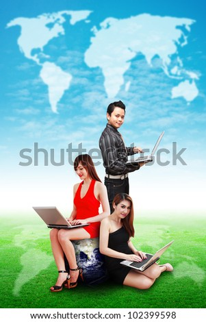 Business people on grass field and blue sky : Elements of this image furnished by NASA - stock photo