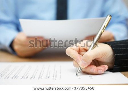 business people on meeting reading and signing contract - stock photo