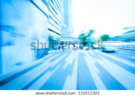 business people on urban city street blur