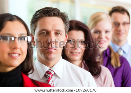 Business people or team in office looking to the viewer - stock photo