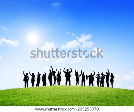 Business people outdoors celebrating success. - stock photo