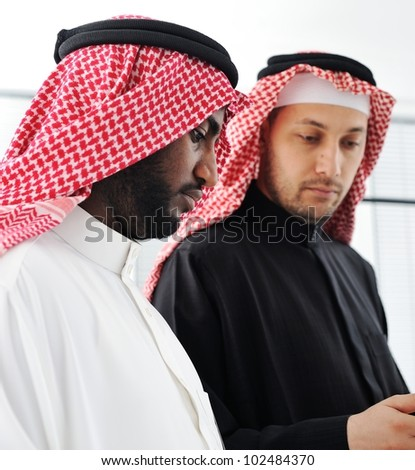Business people planning work in office working on tablet computer - stock photo