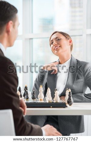 Business people playing chess at office. Business strategy concept
