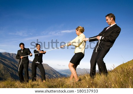 Business People Playing Tug of War on The Mountain, New Zealand