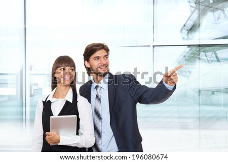 Business people point finger to side empty copy space, businesswomen businessmen happy smile standing in modern office, concept of advertisement product - stock photo