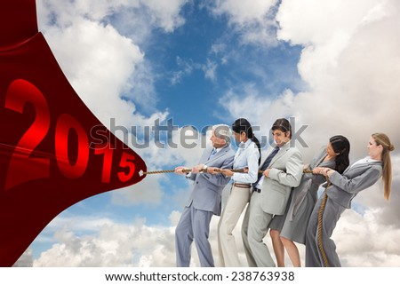 Business people pulling a rope against blue sky with white clouds - stock photo