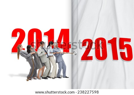 Business people pulling a rope against shadow - stock photo