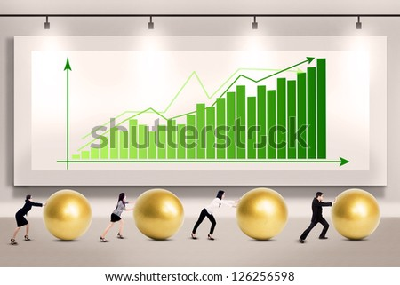 Business people push golden eggs on profit growth bar chart background - stock photo