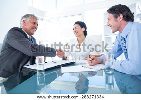 Business people reaching an agreement in an office - stock photo