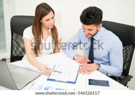 Business people reading a document in their office