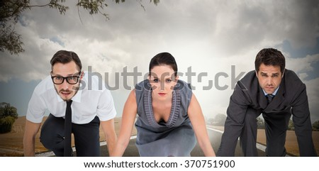Business people ready to start race against road landscape - stock photo
