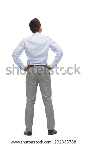business, people, rear view and office concept - businessman looking up from back - stock photo