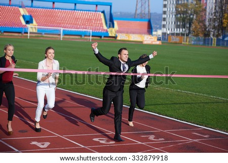 business people running together on  athletics racing track
