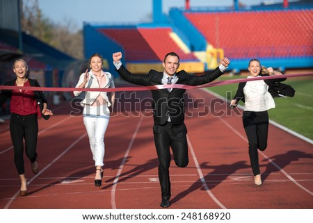 business people running together on racing track
