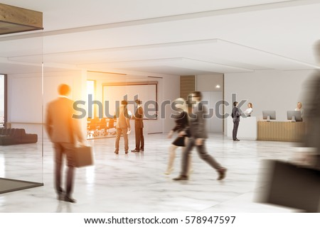 Business People Rushing Through An Office Hall With Marble Floor, A  Reception Counter, A