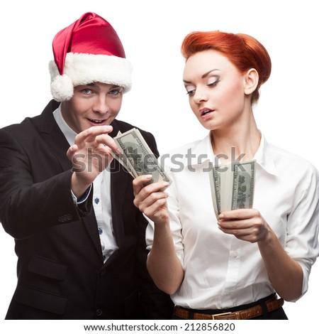 business people santa hat holding money  isolated on white - stock photo