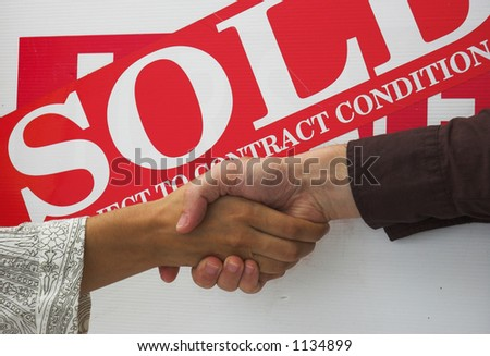 Business people seal contract for sale with a handshake.