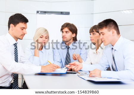 business people serious working discussion on document, meeting, group businesspeople team sitting at desk in office, paperwork - stock photo