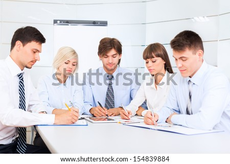 business people serious working document sign up, conference meeting, group businesspeople team sitting at desk in office, writing paperwork - stock photo