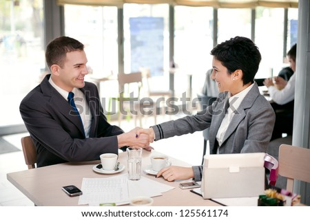 business people shake hands each other at a meeting - stock photo