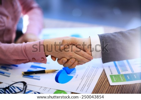 Business people shaking hands - stock photo