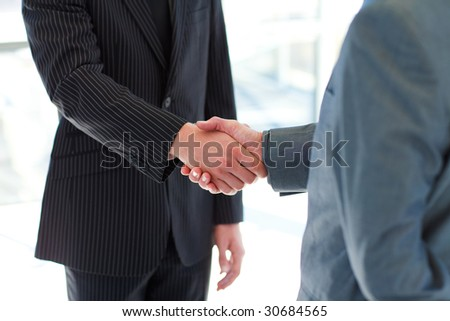 Business people shaking hands after a meeting - stock photo