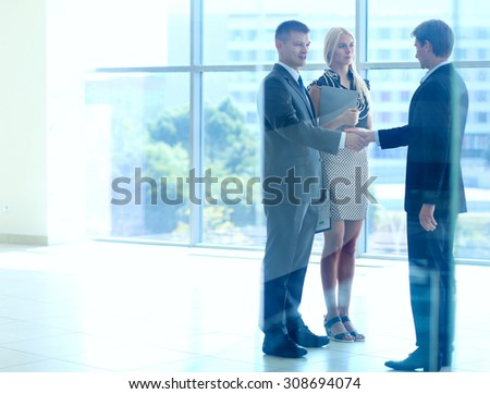 Business people shaking hands after meeting - stock photo