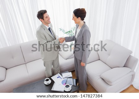 Business people shaking hands after meeting at office - stock photo