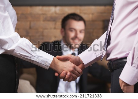 Business people shaking hands after meeting in cafe. Business team shaking hands in cafe - stock photo