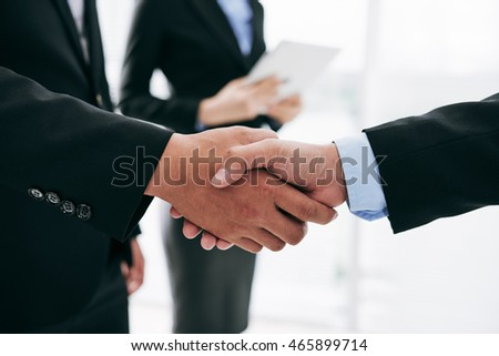 Business people shaking hands after successful deal