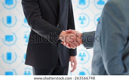 Business people shaking hands against app interface - stock photo