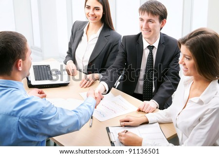 Business people shaking hands at office - stock photo
