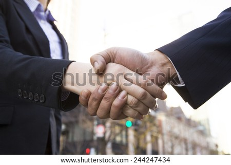 Business people shaking hands at office district