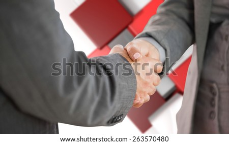 Business people shaking hands close up against abstract tile design