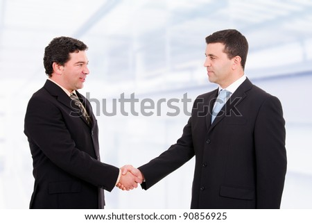 Business people shaking hands, coming to an agreement in the office