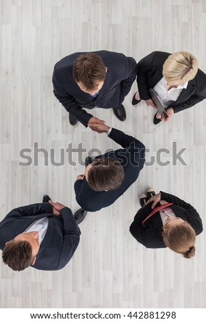 Business people shaking hands, cooperation concept, top view